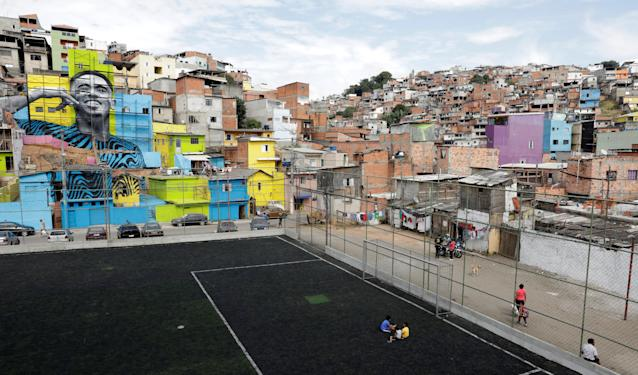 The image of Brazil's soccer player Gabriel Jesus is seen on the walls of houses in the neighbourhood he lived in during his childhood in Sao Paulo, Brazil May 16, 2018. REUTERS/Paulo Whitaker