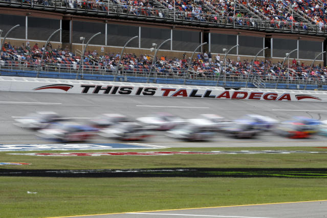 Trucks pass through the tai-oval during the Sugarlands Shine 250 at Talladega Superspeedway, Saturday, Oct 12, 2019, in Talladega, Ala. (AP Photo/Butch Dill)