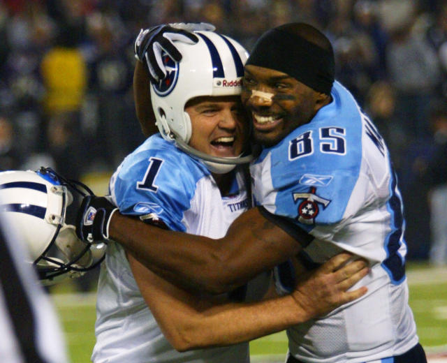 FILE - In this Jan. 3, 2004, file photo, Tennessee Titans' receiver Derrick Mason, right, hugs kicker Gary Anderson after his game-winning fourth quarter touchdown against the Baltimore Ravens during their AFC wildcard playoff game in Baltimore. The Titans playing the Ravens in the divisional round Saturday, Jan. 11, 2020, has revived strong memories of a very intense and bitter playoff rivalry along with the agony of possible Super Bowl titles lost. (AP Photo/Rusty Kennedy, File)