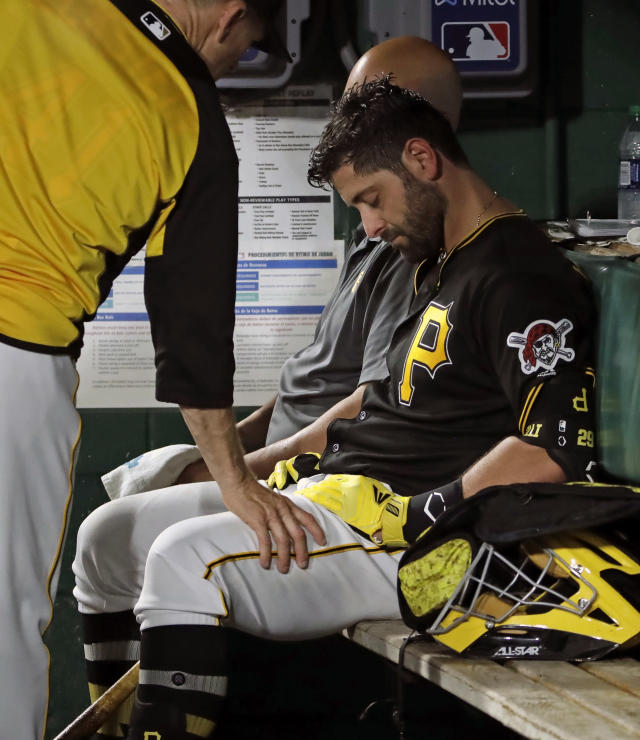 FILE - In this May 25, 2019, file photo, Pittsburgh Pirates catcher Francisco Cervelli is consoled by hitting coach Rick Eckstein, left, after taking himself out of a baseball game against the Los Angeles Dodgers during the fourth inning in Pittsburgh, after being hit in the head by a foul tip earlier in the inning. The Pirates are parting ways with veteran catcher Francisco Cervelli, who has been hampered by multiple concussions this season. The club announced Thursday, Aug. 22, 2019, it requested unconditional release waivers for the 33-year-old Cervelli. (AP Photo/Gene J. Puskar)