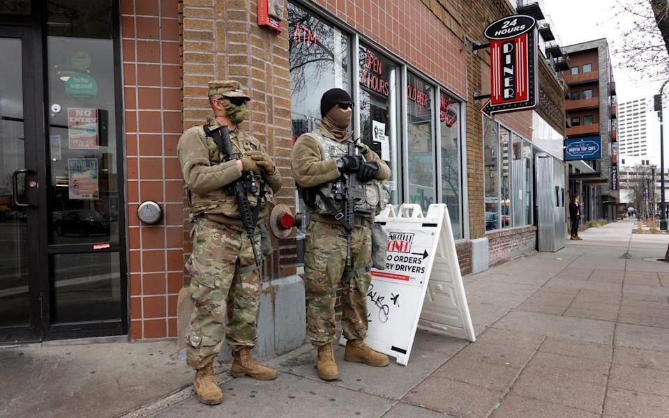 National guard soldier are posted on a street corner near downtown as the city prepares for reaction to the verdict - Scott Olson /Getty
