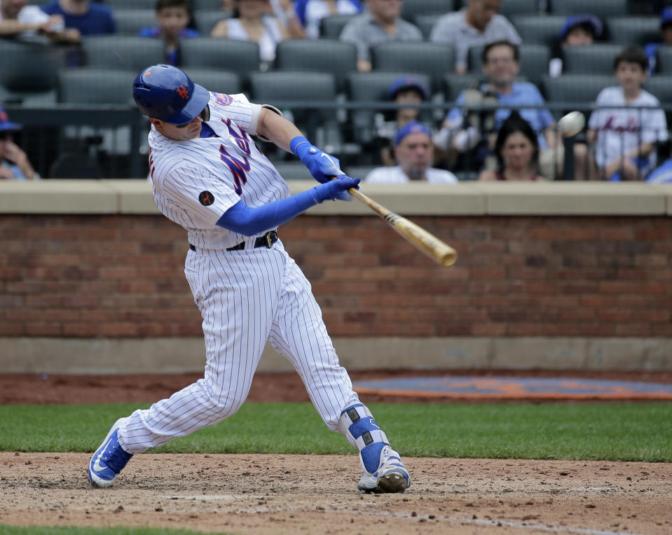 New York Mets' Kevin Plawecki hits a three-run home run during the eighth inning of a baseball game against the Los Angeles Dodgers at Citi Field, Sunday, June 24, 2018, in New York. (AP Photo/Seth Wenig)