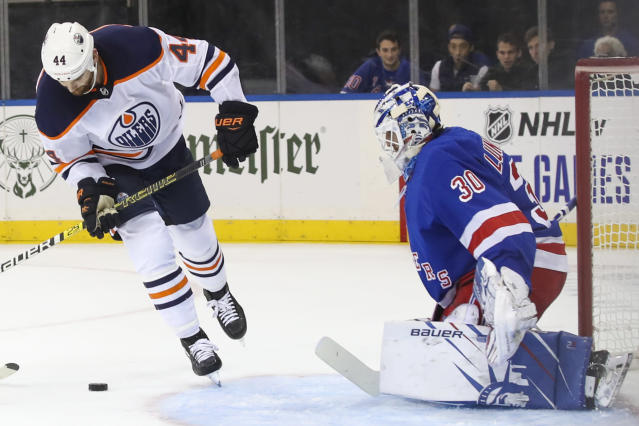 New York Rangers goaltender Henrik Lundqvist (30) defends against Edmonton Oilers right wing Zack Kassian (44) during the first period of an NHL hockey game, Saturday, Oct. 12, 2019, at Madison Square Garden in New York. (AP Photo/Mary Altaffer)