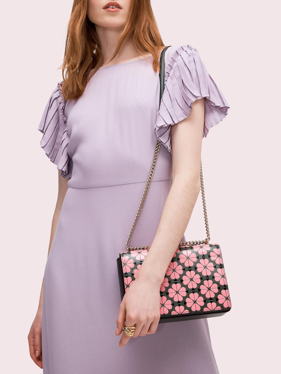 Amelia Spade Flower Medium Convertible Chain Shoulder Bag. Image via Kate Spade.