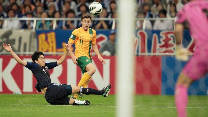 They all count ... Tommy Oar enjoys some good fortune with a cross-shot goal to put Australia into the lead