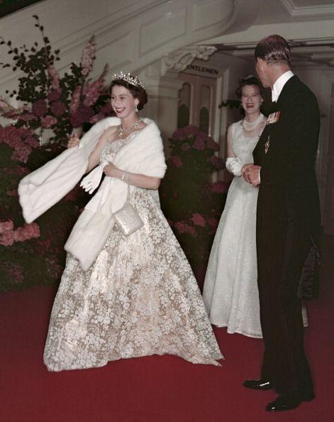 <p>Queen Elizabeth threw a fur stole over an elegant white lace one-shouldered ball gown. The royal's glamorous sartorial choice was worn during her Commonwealth tour in Australia in 1954. </p>