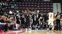 <p>After a 23-2 run in the fourth quarter, the Austin Spurs bench eagerly awaits their championship celebrations as the game hits the two-minute mark. (Photo courtesy: Trung Ho) </p>