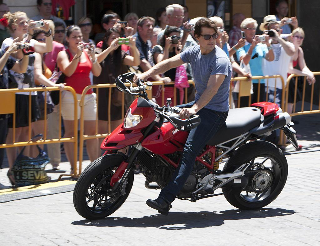 """Tom Cruise was in a bad accident, according to the tabloids, which explain he """"was treating teenage fans to a glimpse of his motorcycling skills when he lost control and crashed into a wall."""" To learn more about Cruise's condition, click over to <a href=""""http://www.gossipcop.com/tom-cruise-motorcycle-accident-crash/"""" target=""""new"""">Gossip Cop.</a> Fernando Camino/<a href=""""http://www.gettyimages.com/"""" target=""""new"""">GettyImages.com</a> - June 16, 2010"""