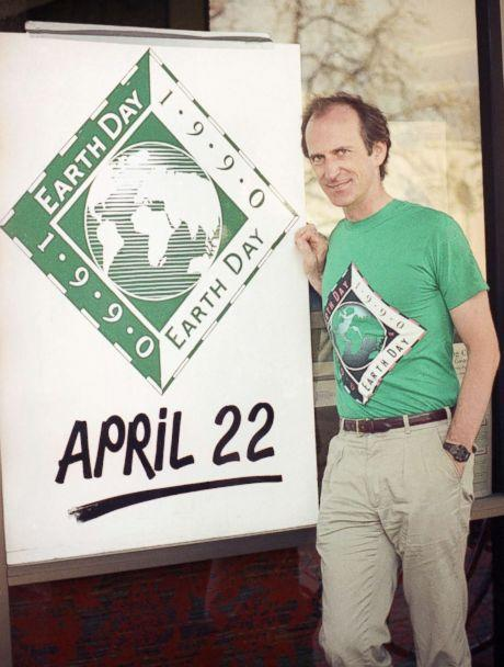 PHOTO: Earth Day founder Denis Hayes poses with an Earth Day sign outside Earth Day headquarters in Palo Alto, Calif., on April 21, 1990, in this file photo. Earth Day is set for April 22 with environmental activities planned throughout the world. (Paul Sakuma/AP, FILE)