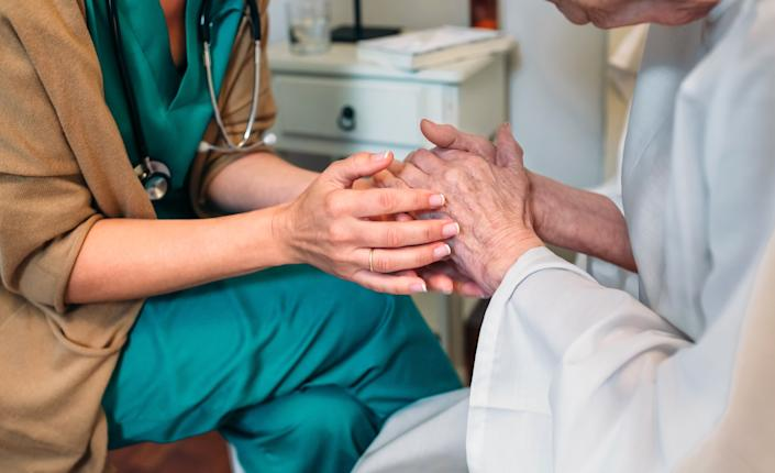 Physicians are reluctant to have these conversations, even when their patients are severely ill. (Photo: David Pereiras / EyeEm via Getty Images)