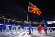 <p>TOKYO, JAPAN - JULY 23: Flag bearers Arbresha Rexhepi and Dejan Georgievski of Team North Macedonia during the Opening Ceremony of the Tokyo 2020 Olympic Games at Olympic Stadium on July 23, 2021 in Tokyo, Japan. (Photo by Matthias Hangst/Getty Images)</p>