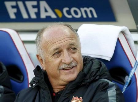 Guangzhou Evergrande's head coach Luiz Felipe Scolari looks at his players before their Club World Cup third-place soccer match against Japan's Sanfrecce Hiroshima in Yokohama, south of Tokyo