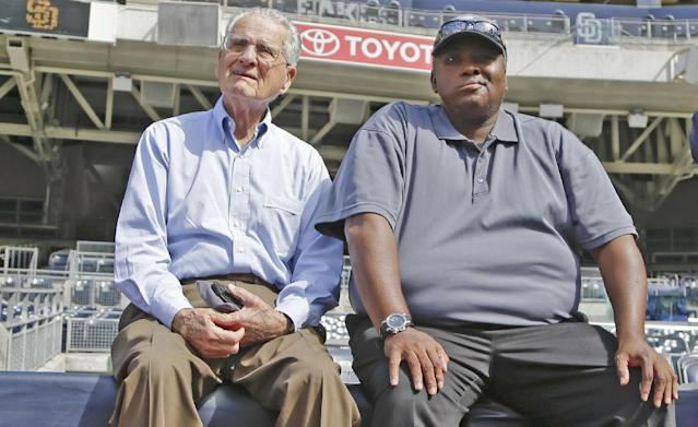 In this June 11, 2013, photo, San Diego Padres broadcaster Jerry Coleman and former player Tony Gwynn watch batting practice before a baseball game between the Padres and the Atlanta Braves in San Diego. Gwynn remains in the thoughts of his San Diego State Aztecs, who have reached the NCAA regionals for the second straight season. Gwynn has been on a medical leave of absence since late March. Coleman died in January. (AP Photo/Lenny Ignelzi)