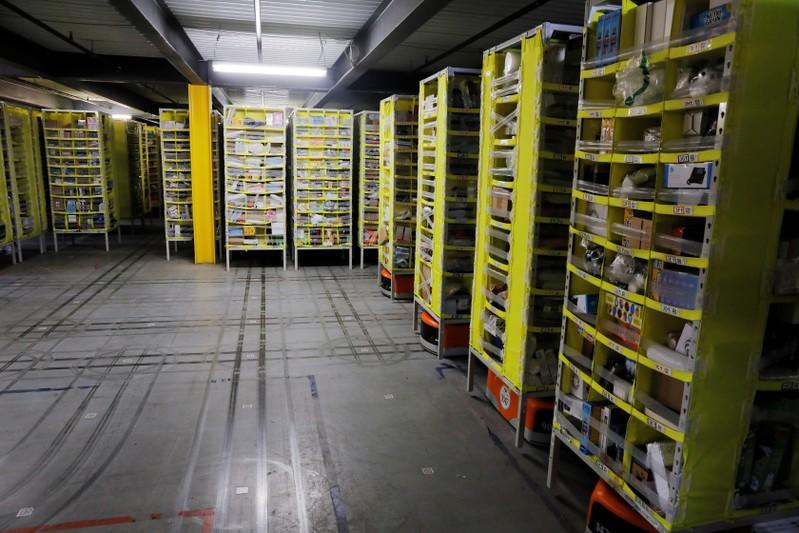 Tracks are left on the floor showing where robots carry shelves full of items inside of an Amazon fulfillment center on Cyber Monday in Robbinsville, New Jersey