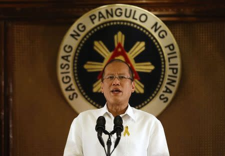 Philippine President Benigno Aquino addresses the nation in a live broadcast at the presidential Malacanang Palace in Manila, July 14, 2014. REUTERS/Erik De Castro