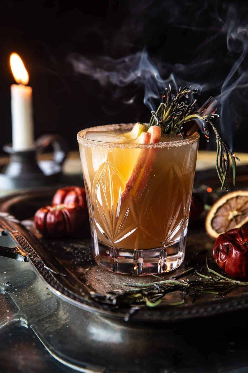 """<p>This spiced bourbon cocktail is topped with sparkling hard cider to give it a bit of fizz. It's full of delicious fall flavors, so you don't need to wait until Halloween night to make it!</p><p><strong>Get the recipe at <a href=""""https://www.halfbakedharvest.com/nightmare-on-bourbon-street/"""" rel=""""nofollow noopener"""" target=""""_blank"""" data-ylk=""""slk:Half Baked Harvest"""" class=""""link rapid-noclick-resp"""">Half Baked Harvest</a>. </strong></p><p><a class=""""link rapid-noclick-resp"""" href=""""https://go.redirectingat.com?id=74968X1596630&url=https%3A%2F%2Fwww.walmart.com%2Fsearch%2F%3Fquery%3Dcocktail%2Bshaker&sref=https%3A%2F%2Fwww.thepioneerwoman.com%2Fholidays-celebrations%2Fg36982659%2Fhalloween-drink-recipes%2F"""" rel=""""nofollow noopener"""" target=""""_blank"""" data-ylk=""""slk:SHOP COCKTAIL SHAKERS"""">SHOP COCKTAIL SHAKERS</a></p>"""