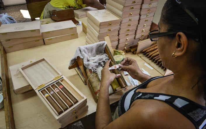 American travelers will be able to use US credit and debit cards in Cuba and bring home up to $400 worth of goods, including a $100 worth of Cuban rum or cigars (AFP Photo/Adalberto Roque)
