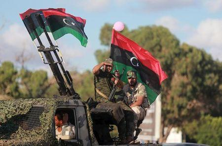 Members of the Libyan army give protection to a demonstration in support of the Libyan army under the leadership of General Khalifa Haftar, in Benghazi
