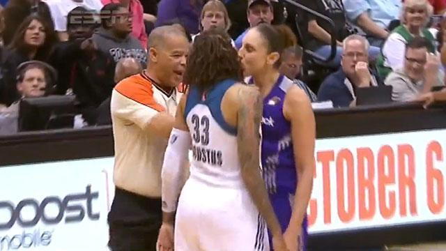 Diana Taurasi kisses Seimone Augustus during WNBA playoff game