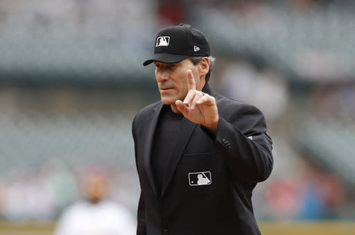 FILE - In this Sept. 1, 2019, file photo, home plate umpire Angel Hernandez signals during the fifth inning of a baseball game between the Detroit Tigers and the Minnesota Twins in Detroit. A major league official testified he suggested Hernandez be removed from consideration for the 2015 World Series because he did not think Commissioner Rob Manfred would approve the umpire to work baseballs premier event. Hernandez sued Major League Baseball in 2017, alleging race discrimination and cited his failure to be assigned to the World Series since 2005 and MLB's failure to promote him to crew chief. (AP Photo/Carlos Osorio, File)