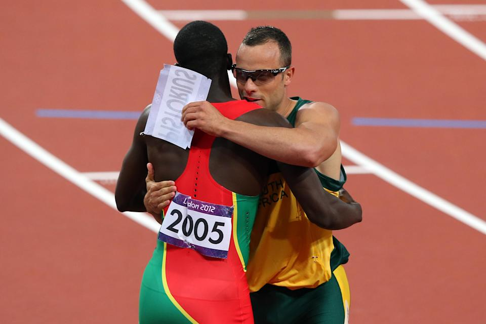 LONDON, ENGLAND - AUGUST 05: Oscar Pistorius of South Africa hugs Kirani James of Grenada after he competed in the Men's 400m Semi Final on Day 9 of the London 2012 Olympic Games at the Olympic Stadium on August 5, 2012 in London, England. (Photo by Alex Livesey/Getty Images)
