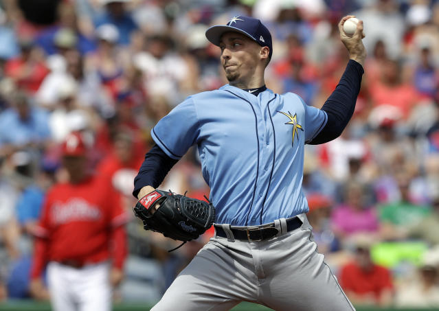 FILE - In this Monday, March 11, 2019, file photo, Tampa Bay Rays' Blake Snell pitches to the Philadelphia Phillies during the second inning of a spring training baseball game in Clearwater, Fla. The Rays bolstered a pitching rotation led by Cy Young Award winner Blake Snell. (AP Photo/Chris O'Meara, File)