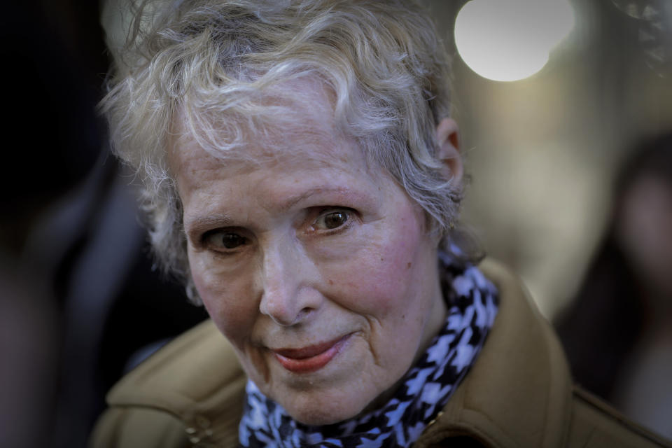 FILE - In this photo from Wednesday, March 4, 2020, E. Jean Carroll talks to reporters outside a courthouse in New York. A New York judge has knocked down President Donald Trump's bid to delay a lawsuit from Carroll, who accused him of rape. Manhattan judge Verna Saunders says in a decision released Thursday, Aug. 6, 2020 that the presidency doesn't shield Trump in the case. (AP Photo/Seth Wenig, File)