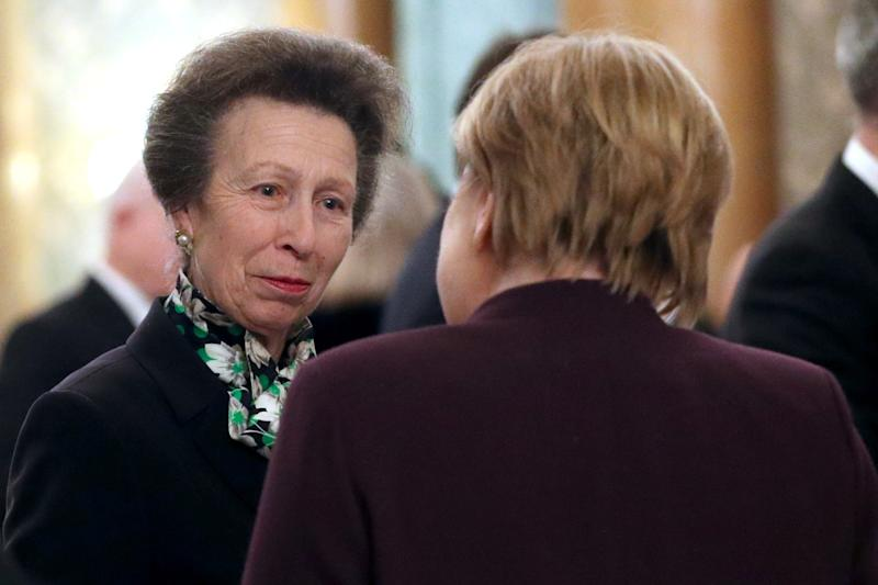 Princess Anne spoke with German Chancellor Angela Merkel at Buckingham Palace. Photo: Getty Images