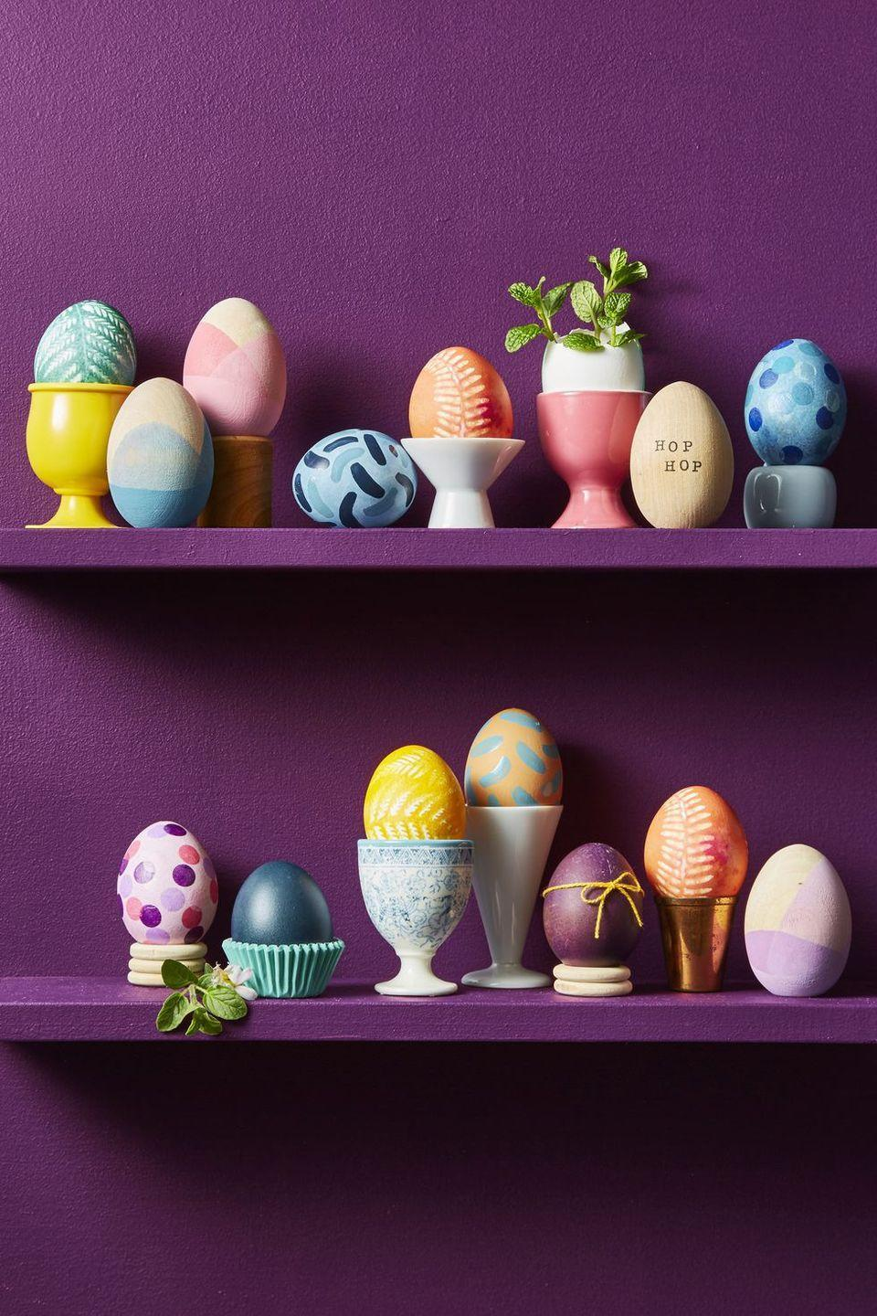 """<p>Sprinkle Easter decor throughout your home — bookcases and cabinets included. The choice is yours: Place decorated eggs on porcelain stands, napkin holders, wood craft rings, or even paper cupcake liners for an extra oomph.</p><p><a class=""""link rapid-noclick-resp"""" href=""""https://www.amazon.com/PORCELAIN-CUPCAKE-TREAT-PEDESTAL-STANDS/dp/B00B0139EM?tag=syn-yahoo-20&ascsubtag=%5Bartid%7C10055.g.2217%5Bsrc%7Cyahoo-us"""" rel=""""nofollow noopener"""" target=""""_blank"""" data-ylk=""""slk:BUY PORCELAIN STANDS"""">BUY PORCELAIN STANDS</a> <br></p>"""