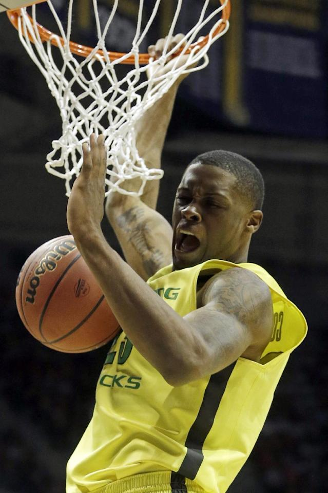 Oregon forward Elgin Cook (23) dunks during the second half of a second-round game against the BYU in the NCAA college basketball tournament Thursday, March 20, 2014, in Milwaukee. (AP Photo/Morry Gash)