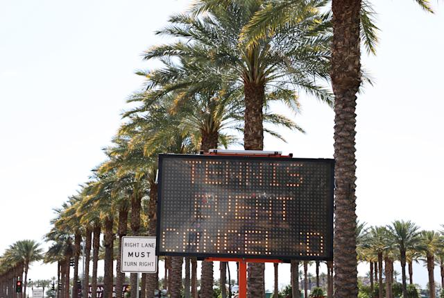 "INDIAN WELLS, CALIFORNIA - MARCH 09: A ""Tennis Is Cancelled"" sign flashes outside the Indian Wells Tennis Garden on March 09, 2020 in Indian Wells, California. The BNP Paribas Open was cancelled by the Riverside County Public Health Department, as county officials declared a public health emergency when a case of coronavirus (COVID-19) was confirmed in the area. (Photo by Al Bello/Getty Images)"
