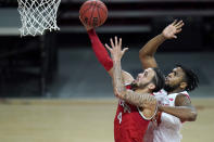 Ohio State guard Duane Washington Jr., left, goes up for a shot against Maryland forward Donta Scott during the second half of an NCAA college basketball game, Monday, Feb. 8, 2021, in College Park, Md. Ohio State won 73-65. (AP Photo/Julio Cortez)