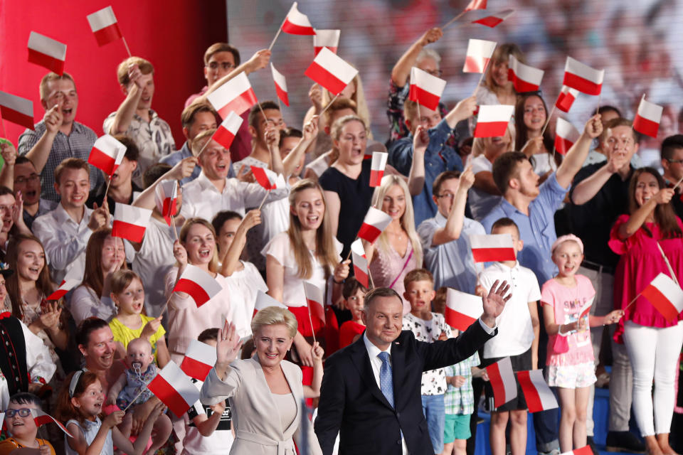 FILE - In this June 28, 2020, file photo, President Andrzej Duda and his wife Agata Kornhauser-Duda wave to supporters shortly after voting ended in the presidential election in Lowicz, Poland. Duda and Warsaw Mayor Rafal Trzaskowski are heading into a tight presidential runoff that is seen as an important test for populism in Europe. The Sunday, July 12 election comes after a bitter campaign that has exacerbated a conservative-liberal divide in the country. (AP Photo/Petr David Josek, File)