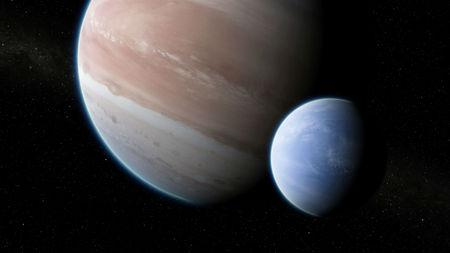 An artist's impression of the exoplanet Kepler-1625b, transiting the star, with the newly discovered exomoon in tow
