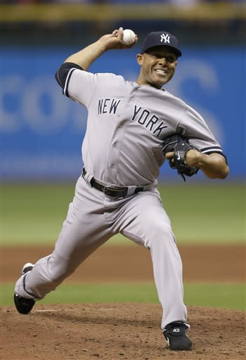 New York Yankees relief pitcher Mariano Rivera delivers in the ninth inning to the Tampa Bay Rays during a baseball game Tuesday, April 23, 2013, in St. Petersburg, Fla. (AP Photo/Chris O'Meara)