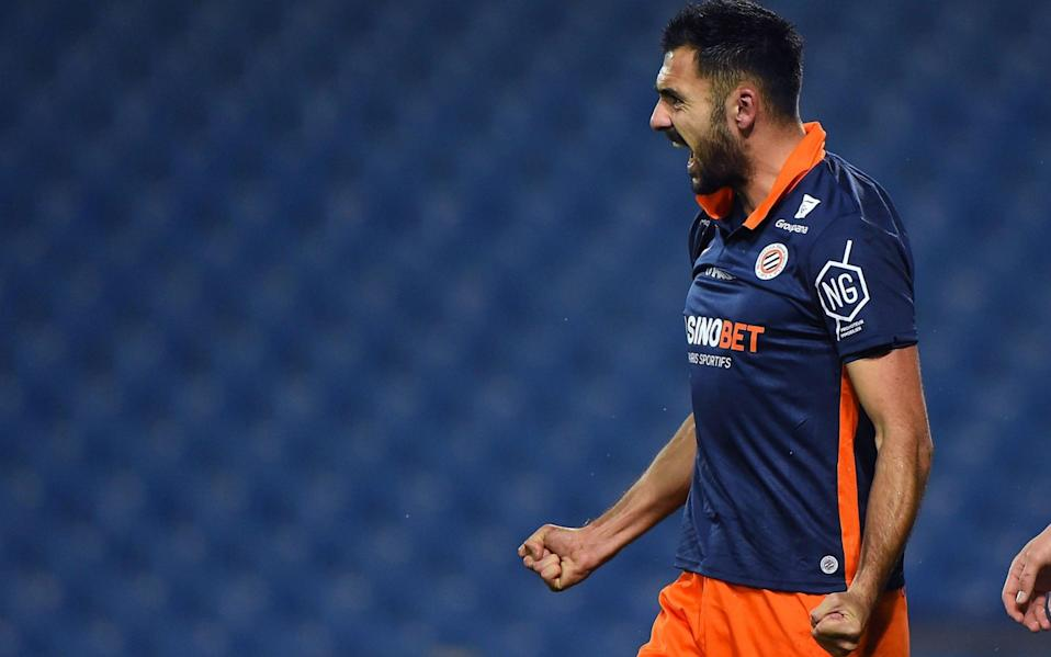 Montpellier's French forward Gaetan Laborde celebrates after scoring a goal during the French L1 football match between Montpellier and LOSC Lille at the Mosson stadium in Montpellier on December 23, 2020. - AFP