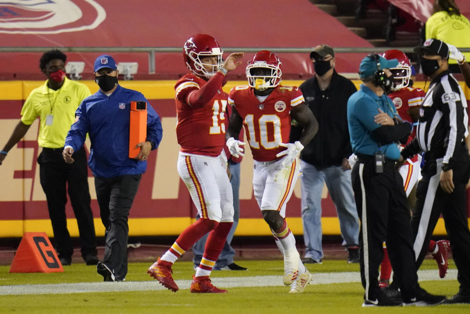 Kansas City Chiefs wide receiver Tyreek Hill (10) celebrates with teammate Patrick Mahomes (15)