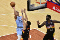 Memphis Grizzlies guard Desmond Bane (22) shoots against Phoenix Suns guard Devin Booker (1) as Suns center Deandre Ayton (22) moves for position in the second half of an NBA basketball game Saturday, Feb. 20, 2021, in Memphis, Tenn. (AP Photo/Brandon Dill)