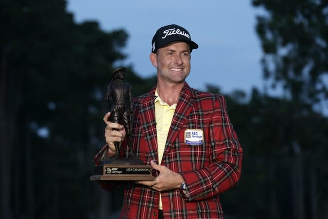 Webb Simpson holds the championship trophy after winning the RBC Heritage golf tournament(Gerry Broome/AP)