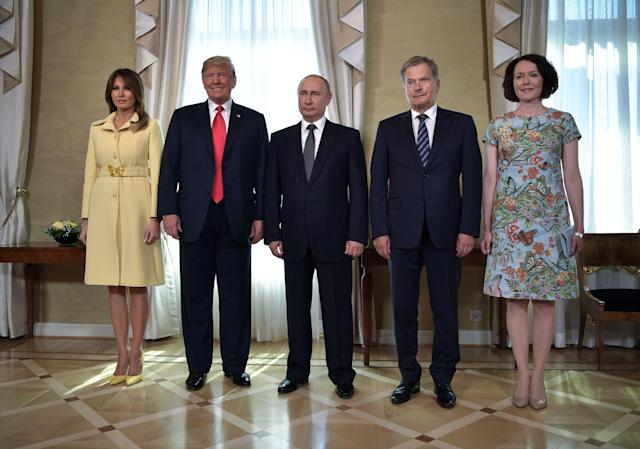 <p>(Left to right) U.S. First Lady Melania Trump, U.S. President Donald Trump, Russia's President Vladimir Putin, Finnish President Sauli Niinisto and his wife Jenni Haukio pose at the Presidential Palace in Helsinki, on July 16, 2018. (Photo: Aleksey Nikolskyi/Getty Images) </p>