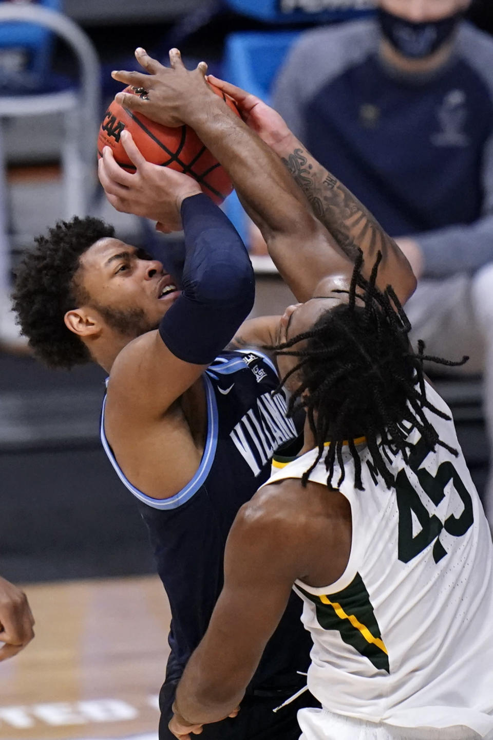 Baylor guard Davion Mitchell (45) blocks a Villanova guard Justin Moore (5) shot in the second half of a Sweet 16 game in the NCAA men's college basketball tournament at Hinkle Fieldhouse in Indianapolis, Saturday, March 27, 2021. (AP Photo/AJ Mast)
