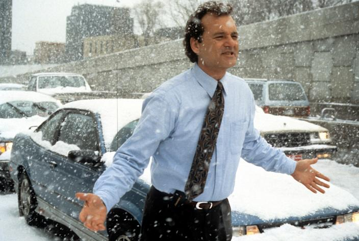 Bill Murray runs through the snow in a scene from the film 'Groundhog Day', 1993. (Photo by Columbia Pictures/Getty Images)