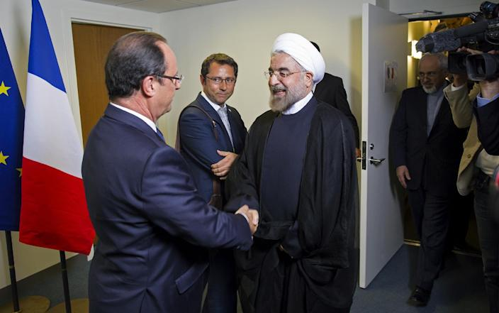 Iranian President Hasan Rouhani, right, meets with French President Francois Hollande during the 68th session of the United Nations General Assembly at United Nations headquarters Tuesday, Sept. 24, 2013. (AP Photo/Craig Ruttle)