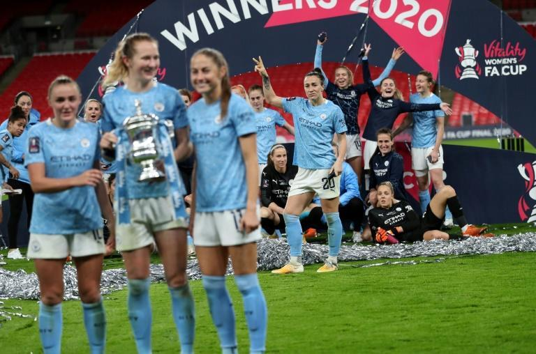 Lucy Bronze (C back) with her Manchester City teammates as they celebrate winning the English Women's FA Cup final against Everton last November