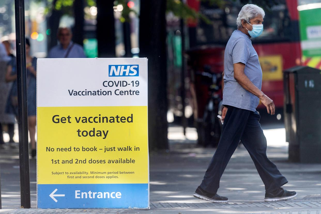 A man walks past an NHS Covid-19 vaccination centre in London, Britain, on Sept. 7, 2021. Britain has recorded more than 7 million COVID-19 cases since the start of the pandemic, according to the latest official data released on Monday.   The country reported another 41,192 coronavirus cases in the latest 24-hour period, bringing the total number of coronavirus cases in the country to 7,018,921, official figures showed. (Photo by Ray Tang/Xinhua via Getty Images)