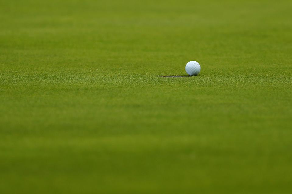 PORTRUSH, NORTHERN IRELAND - JULY 20: The ball of Jon Rahm of Spain sits on the edge of the hole on the 18th green during the third round of the 148th Open Championship held on the Dunluce Links at Royal Portrush Golf Club on July 20, 2019 in Portrush, United Kingdom. (Photo by Francois Nel/Getty Images)