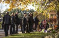 People line up for public visitation for Cpl. Nathan Cirillo outside a funeral home in Hamilton, October 27, 2014. REUTERS/Mark Blinch