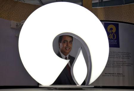 FILE PHOTO: The logo of Reliance Industries is pictured in a stall at the Vibrant Gujarat Global Trade Show at Gandhinagar, India, January 17, 2019. REUTERS/Amit Dave/File Photo