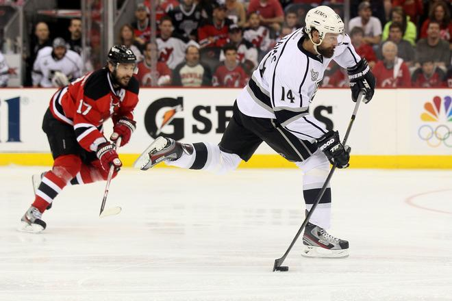 NEWARK, NJ - JUNE 09: Justin Williams #14 of the Los Angeles Kings shoots and scores in the second period against the New Jersey Devils during Game Five of the 2012 NHL Stanley Cup Final at the Prudential Center on June 9, 2012 in Newark, New Jersey.  (Photo by Elsa/Getty Images)