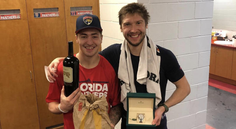 Florida Panthers teammates Frank Vatrano (left) poses with Sergei Bobrovsky (right) and the gifts he received from the Russian goaltender after giving up his number. (Instagram//@frank_vatrano)